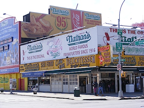 This yellow and white building is covered with signs