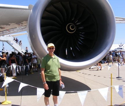 Al is dwarfed by the large air intake behind him.