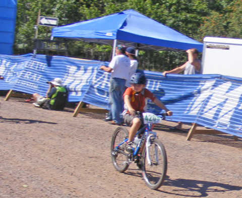 Caden rides past the finish line