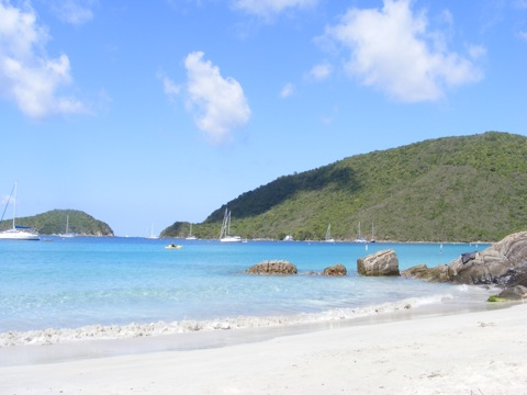The campground beach at             Little Maho Bay, looking east past the rocks marking the             end of the bay and looking over Francis Bay beyond