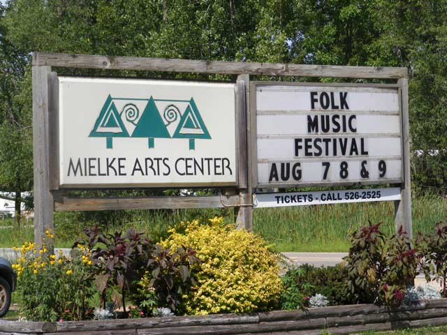 Sign at the Mielke Arts Center announcing the Folk Music Festival, Aug 7-9