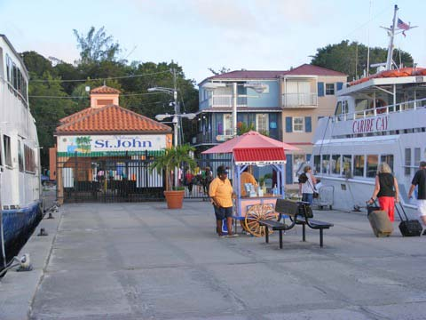 The ferry dock at Cruz Bay, St. John, VI with a woman vendor on Jan 21, 2010